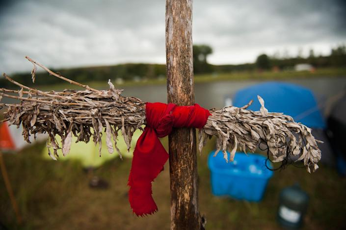 <p>A sage tie, used by some Native American tribes to clear negative energy or spirits, hangs at the Seven Councils camp on the banks of the Cannonball River in North Dakota amid protests against the Dakota Access pipeline on Sept. 7, 2016. (Photo: Andrew Cullen/Reuters) </p>