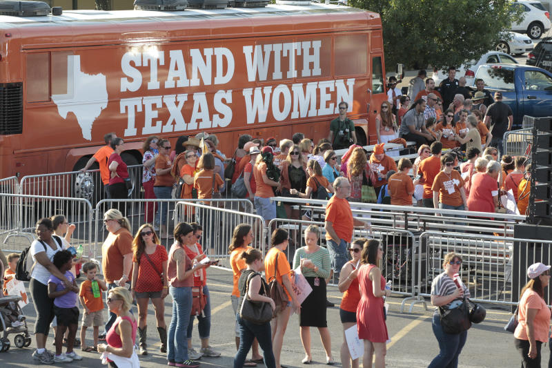 The crowd builds before Senator Wendy Davis arrives with other dignitaries for the Stand With Women tour in Fort Worth, Texas on Wednesday July 10, 2013. The group spoke on the lack of statewide hearings on the abortion bill. (AP Photo/Star-Telegram, Ron T. Ennis)