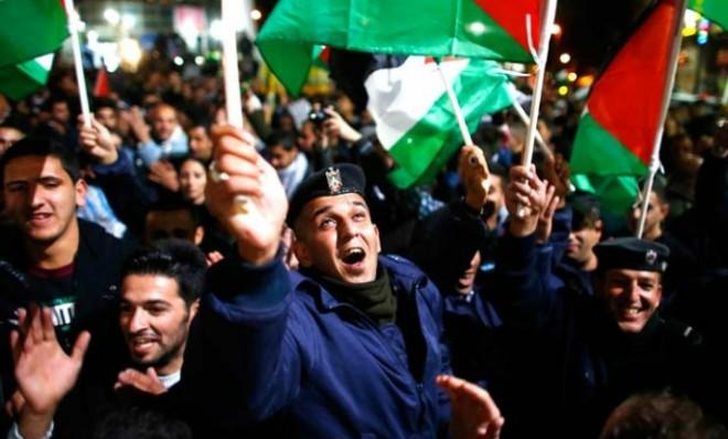 Palestinians celebrate the U.N.'s upgrade on Thursday of the Palestinian Authority's status to non-member state.