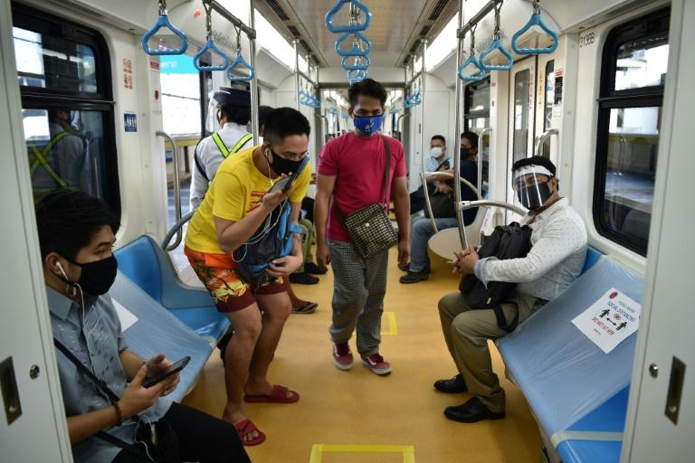 Normally packed train carriages in Manila had plastic sheets covering some seats and markers on the floor to ensure the few passengers on board kept their distance from each other