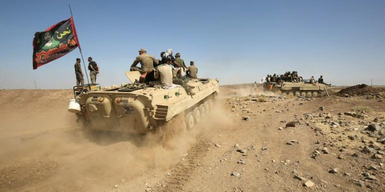 Fighters of the Hashed al-Shaabi paramilitary group are deployed south of Iraqi Kurdistan around Hawija