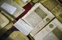 In this photo taken Tuesday, Mar. 16, 2004, some of the 20,000 preserved ancient Islamic manuscripts which rest in air-conditioned rooms are displayed at the Ahmed Baba Institute in Timbuktu, Mali. Islamist extremists torched the library containing the historic manuscripts in Timbuktu, the mayor of the town said Monday, Jan. 28, 2013, while owners have succeeded in removing some of the manuscripts from Timbuktu to save them and others have been carefully hidden away from the Islamists. (AP Photo/Ben Curtis)