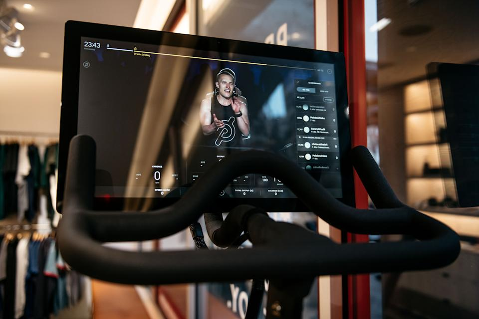 NEW YORK, NY - DECEMBER 04: An instructor is seen on the video display of a Peloton stationary bike at the fitness company's studio on Manhattan's 23rd Street on December 4, 2019 in New York City. Peloton and its model of on-demand video cycling classes has come under fire after the release of a new commercial that has been criticized by some as sexist and classist. (Photo by Scott Heins/Getty Images)