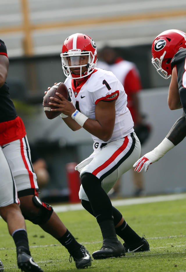 Georgia quarterback Justin Fields looks for an open receiver during the first half of the G day inter squad spring football game Saturday, April 21, 2018, in Athens, Ga. (AP Photo/John Bazemore)