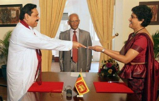 Shirani Bandaranayake (R) was appointed Sri Lanka's first woman chief justice in 2011