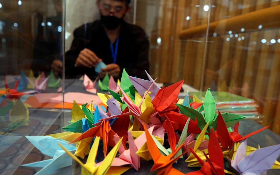 Visitors and mourners have brought offerings of Sadako origami paper cranes to mark the event - RUNGROJ YONGRIT/EPA-EFE/Shutterstock/Shutterstock
