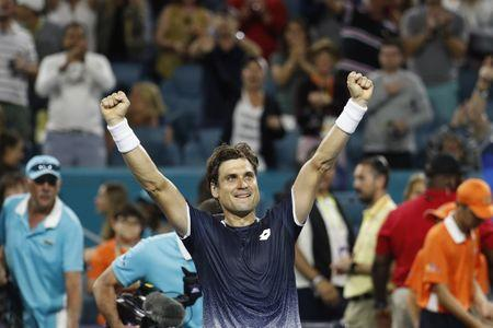 Mar 23, 2019; Miami Gardens, FL, USA; David Ferrer of Spain salutes the crowd after his match against Alexander Zverev of Germany (not pictured) in the second round of the Miami Open at Miami Open Tennis Complex. Mandatory Credit: Geoff Burke-USA TODAY Sports