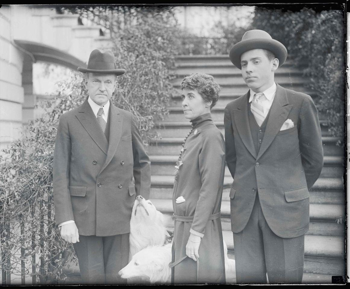 <p>President Calvin Coolidge enjoys Christmas at the White House in 1925 with First Lady Grace Coolidge, their son, John, and the family dogs.</p>