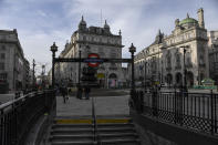 A near empty Piccadilly Circus, in London, Tuesday, Nov. 24, 2020. Haircuts, shopping trips and visits to the pub will be back on the agenda for millions of people when a four-week lockdown in England comes to an end next week, British Prime Minister Boris Johnson said Monday. (AP Photo/Alberto Pezzali)