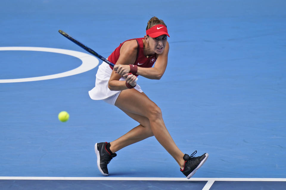 Belinda Bencic, of Switzerland, plays Elena Rybakina, of Kazakhstan, during the semifinals of the tennis competition at the 2020 Summer Olympics, Thursday, July 29, 2021, in Tokyo, Japan. (AP Photo/Seth Wenig)