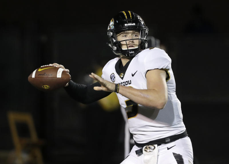 FILE - In this Nov. 18, 2017, file photo, Missouri quarterback Drew Lock passes against Vanderbilt in the first half of an NCAA college football game in Nashville, Tenn. Lock set an Southeastern Conference record last season with 44 touchdown passes. (AP Photo/Mark Humphrey, File)