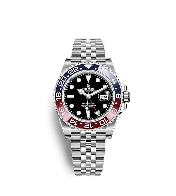 """<p><strong>Rolex</strong></p><p>tourneau.com</p><p><strong>$9700.00</strong></p><p><a href=""""https://www.tourneau.com/watches/rolex/gmt-master-ii-m126710blroz0001.html"""" rel=""""nofollow noopener"""" target=""""_blank"""" data-ylk=""""slk:Shop Now"""" class=""""link rapid-noclick-resp"""">Shop Now</a></p><p>""""My daughter, Penelope, was born in May, and COVID-19 be damned—I'm going to get a watch to commemorate the occasion this Christmas. This Rolex GMT Master II—nicknamed the """"Pepsi"""" for its blue-and-red ceramic bezel—is the platonic ideal for travelers in that it gives the hour in two timezones and is submersible up to 330 feet. If I ever find myself in a situation where I'm doing a little moonlight shark diving off the coast of the Maldives, but need to get on a business call at 10am Easter Standard Time, with this watch I won't miss my window. And for all your watch needs, I recommend you go see Igor Rubanov at Tourneau. </p><p>- <em>Charles Curkin, Articles Editor</em></p>"""