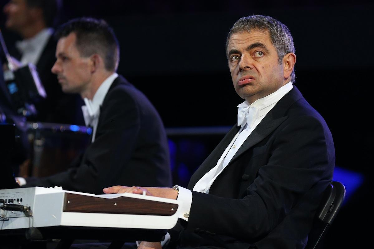 "<p class=""MsoNormal""><b><span style=""font-size:11pt;font-family:Arial;color:black;"">Rowan Atkinson</span></b></p>  <p class=""MsoNormal""><span style=""font-size:11pt;font-family:Arial;color:black;"">Mr. Bean is alive and well and showed up at the opening ceremony. That's right, Rowan Atkinson reprised his much-loved and ever-silent character Mr. Bean, bringing some laughs to the official launch of the Games as he ""accompanied"" the London Symphony Orchestra playing the ""Chariots of Fire"" theme.<b> </b></span></p>  <p class=""MsoNormal""><span style=""font-size:11pt;font-family:Arial;"">(Photo by Cameron Spencer/Getty Images)<b><span style=""color:black;""></span></b></span></p>"