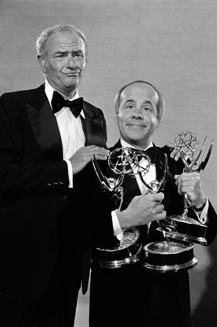 "FILE - In this Sept. 18, 1978 file photo, comedians Harvey Korman, left, and Tim Conway show off three Emmy Awards for the ""Carol Burnett Show"" at the Pasadena Civic Auditorium, in Pasadena, Calif. Conway, the stellar second banana to Carol Burnett who won four Emmy Awards on her TV variety show, has died, according to his publicist. He was 85. Conway died Tuesday morning, May 14, 2019, after a long illness in Los Angeles, according to Howard Bragman, who heads LaBrea Media. (AP Photo/David Yarnold, File)"