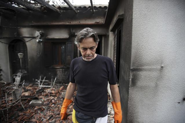 <p>Girogos Handrinos stands outside his burned house in Mati, east of Athens, Thursday, July 26, 2018. (Photo: Thanassis Stavrakis/AP) </p>