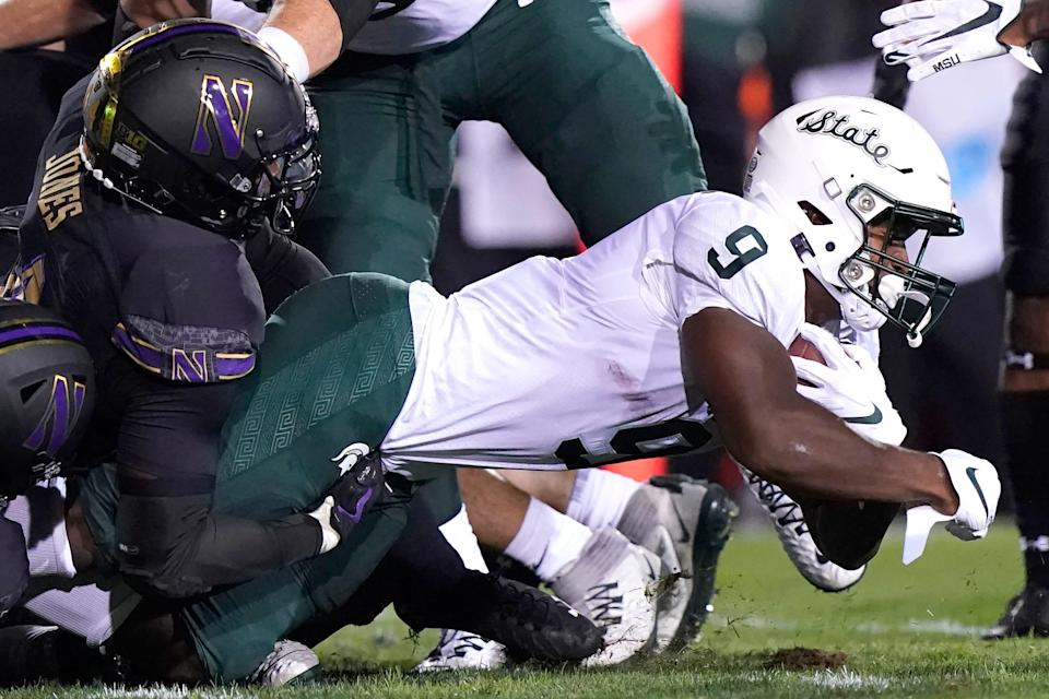 Michigan State running back Kenneth Walker III., right, is tackled by Northwestern linebacker Khalid Jones during the first half on Friday, Sept. 3, 2021, in Evanston, Illinois.