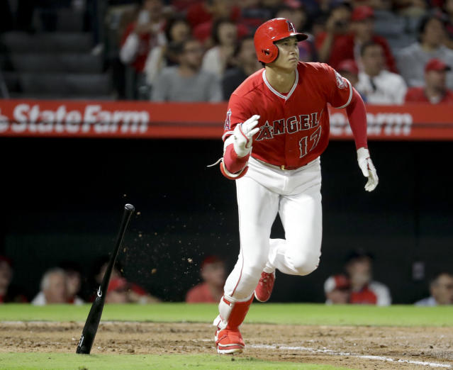Los Angeles Angels' Shohei Ohtani, of Japan, watches his double against the Texas Rangers during the third inning of a baseball game in Anaheim, Calif., Wednesday, Sept. 12, 2018. (AP Photo/Chris Carlson)