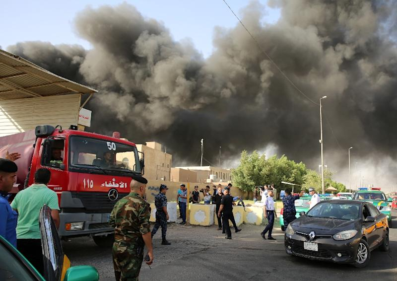 Two hours after the blaze broke out firefighters were still struggling to put out the flames at Iraq's biggest ballot warehouse in eastern Baghdad (AFP Photo/SABAH ARAR)