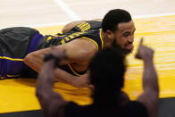 Los Angeles Lakers guard Talen Horton-Tucker chases a loose ball out of bounds after being fouled in the closing seconds of the second half of an NBA basketball game as a fan cheers Wednesday, May 12, 2021, in Los Angeles. (AP Photo/Mark J. Terrill)
