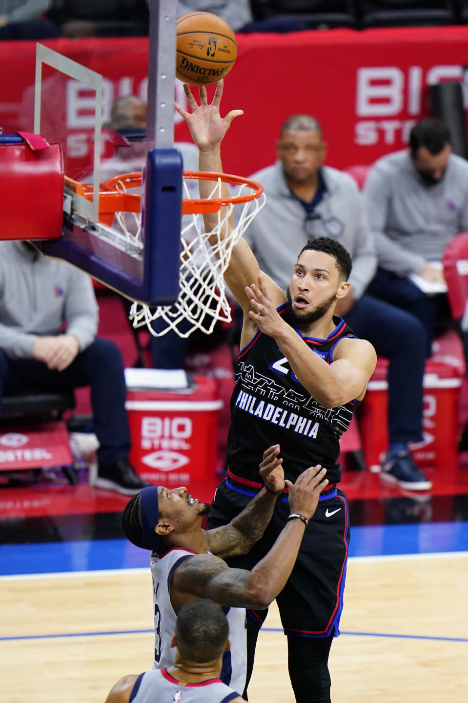 Philadelphia 76ers' Ben Simmons, right, goes up for a shot against Washington Wizards' Bradley Beal during the first half of Game 2 in a first-round NBA basketball playoff series, Wednesday, May 26, 2021, in Philadelphia. Ben Simmons can't shoot and lost his confidence. He blamed a mental block on the worst free-throw shooting percentage in NBA playoff history. The 76ers head into the offseason faced with a big question - do they try and salvage Simmons or deal the former No. 1 pick. (AP Photo/Matt Slocum)