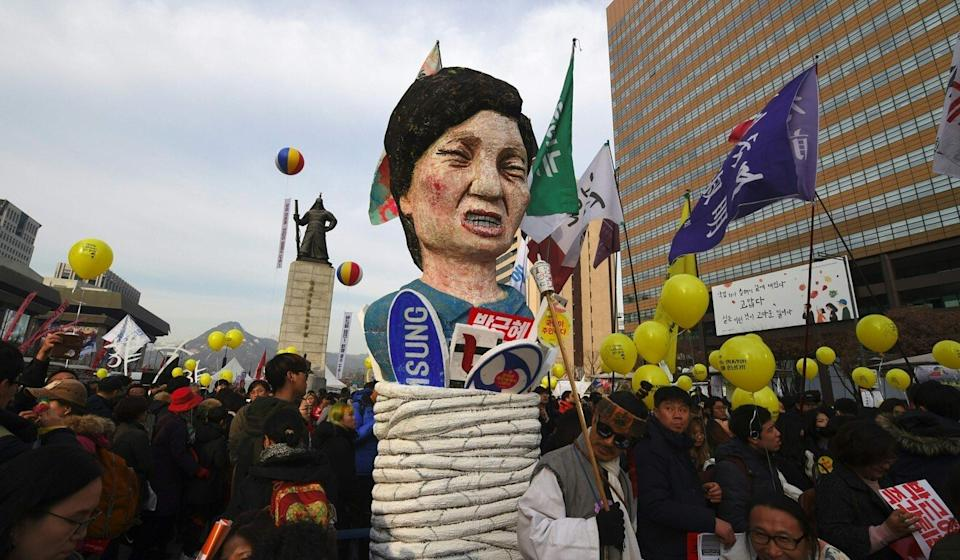 Protesters carry an effigy of then South Korean president Park Geun-hye during a rally against her in Seoul. Photo: AFP
