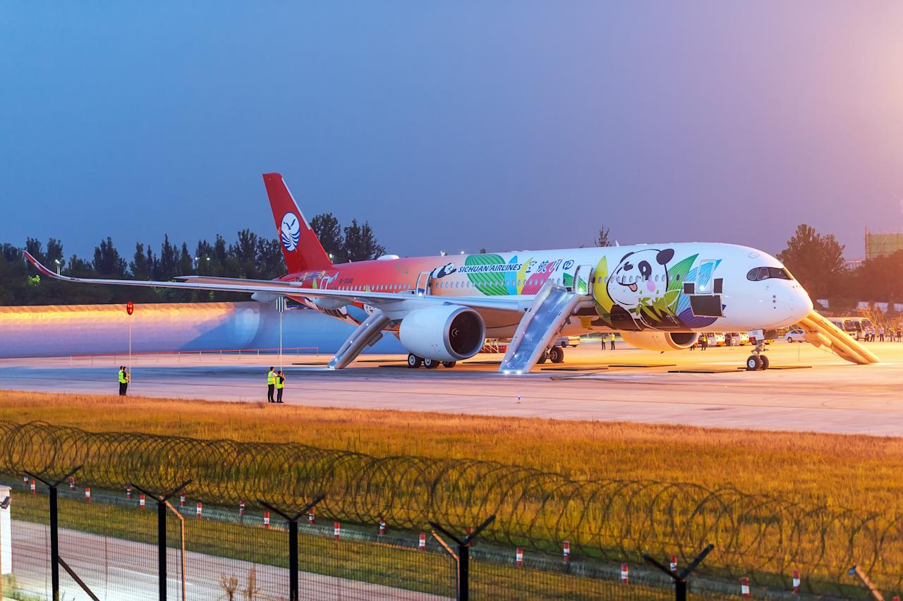 <p>Sichuan Airlines' Airbus A350 is seen at Chengdu Shuangliu International Airport on August 15, 2018 in Chengdu, Sichuan Province of China. Sichuan Airlines' Airbus A350 painted with pandas attends an emergency evacuation drill before flying with passengers in Chengdu on Wednesday. (Photo by Lin Fangchao/VCG via Getty Images) </p>