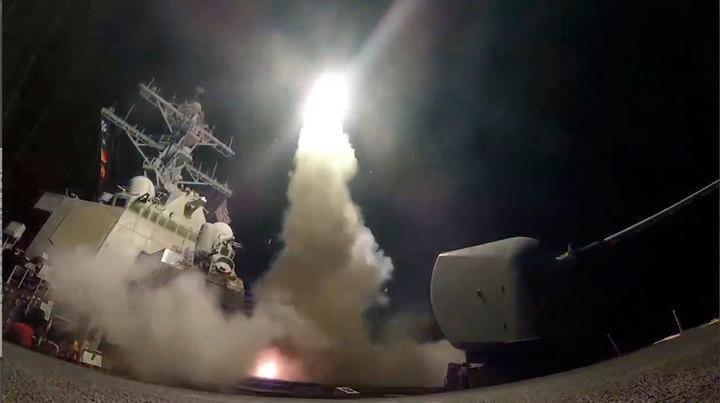 The guided-missile destroyer Porter launches a Tomahawk missile at the Syrian air base on April 7, 2017.