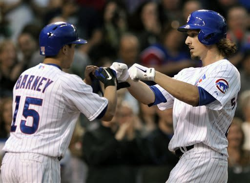 Chicago Cubs' Jeff Samardzija, right, celebrates with teammate Darwin Barney, left, at home plate after hitting a two-run home run during the second inning of a baseball game against the Colorado Rockies in Chicago, Wednesday, May 15, 2013. (AP Photo/Paul Beaty)
