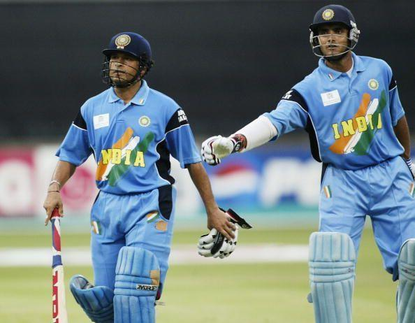 Sachin Tendulkar (left) of India is given a pat on the back by his opening partner