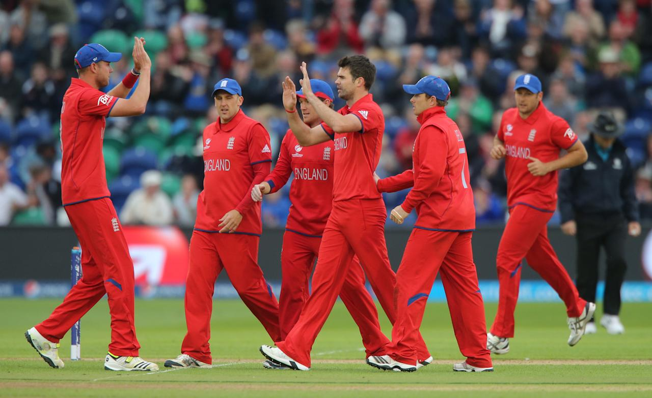 England's bowler James Anderson celebrates after Jonathan Trott caught New Zealand batsman Luke Ronchi during the ICC Champions Trophy match at the SWALEC Stadium, Cardiff.