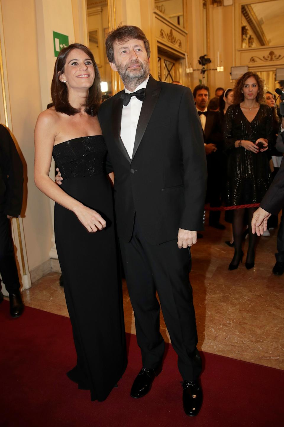 """Italian Culture Minister Dario Franceschini and his wife Michela Di Biase arrive for the gala premiere of La Scala opera house, in Milan, Italy, Saturday, Dec. 7, 2019. Milan's storied La Scala opens its 2019-2020 season on Saturday with Puccini's """"Tosca,"""" which stars Russian soprano Anna Netrebko as the object of unwanted sexual attention from a powerful authority figure. (AP Photo/Luca Bruno) (Photo: ASSOCIATED PRESS)"""