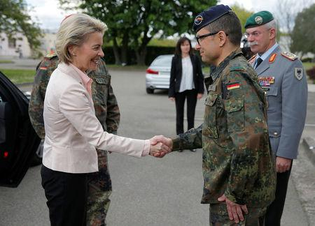"German Defence Minister Ursula von der Leyen (L) is welcomed by the commander of the German 291st fighter squadron Marc-Ulrich Cropp, at her arrival at the squadron based at the ""Quartier Leclerc"", a military facility for French and German military units in Illkirch-Graffenstaden near Strasbourg, France May 3, 2017. REUTERS/Vincent Kessler"