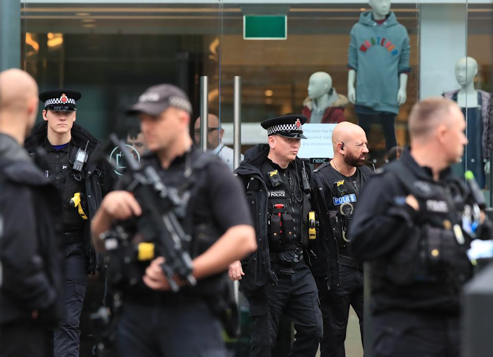 Armed police officers outside the Arndale Centre in Manchester where at least five people have been treated after a stabbing incident.