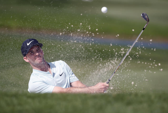FILE - In this Thursday, Feb. 22, 2018 file photo, Denny McCarthy hits out of a bunker on the ninth hole during the first round of the Honda Classic golf tournament in Palm Beach Gardens, Fla. Golf barely got out of January when it was hit with what must feel like a two-shot penalty. Odds are the negative attention on the new set of modern rules will have subsided before those four glorious days in April during the Masters unless, of course, the next man in a green jacket makes his final putt with the flagstick in the cup. (AP Photo/Wilfredo Lee, File)