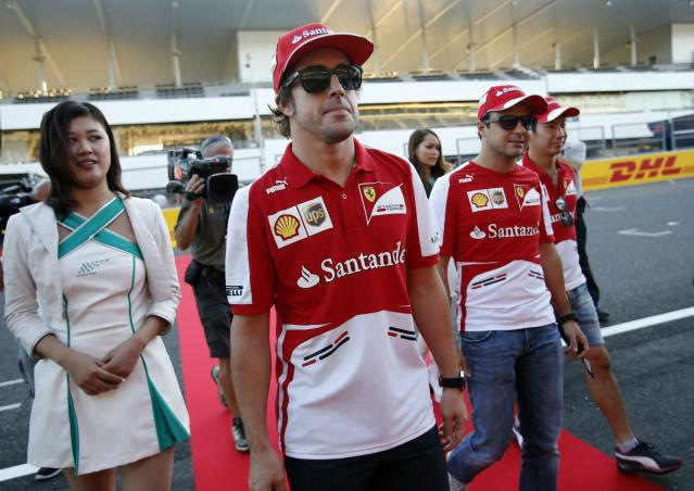 Ferrari Formula One driver Fernando Alonso of Spain (C), teammate Felipe Massa of Brazil (2nd R) and test driver Kamui Kobayashi of Japan (R) attend an autograph session for fans at the Suzuka circuit October 10, 2013, ahead of Sunday's Japanese F1 Grand Prix. REUTERS/Issei Kato (JAPAN - Tags: SPORT MOTORSPORT F1)