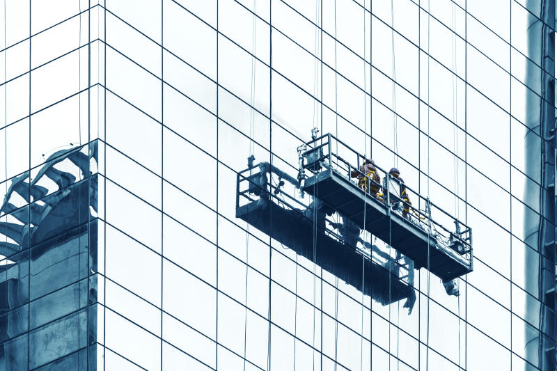 Photo of a window washer, at an elevator.