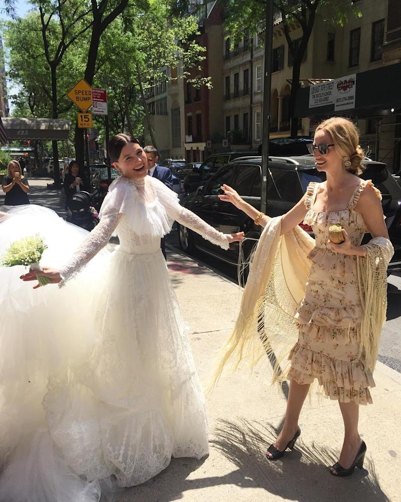 Tabitha Simmons in her Dolce & Gabbana wedding dress on her wedding day, posing with Lauren Santo Domingo on the Upper East Side.