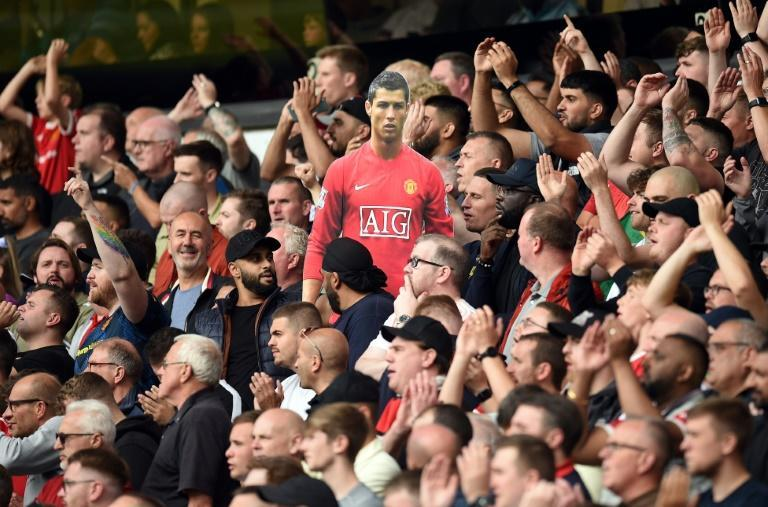 Manchester United fans celebrated the return of Cristiano Ronaldo with a cardboard cut out at Wolves (AFP/Oli SCARFF)
