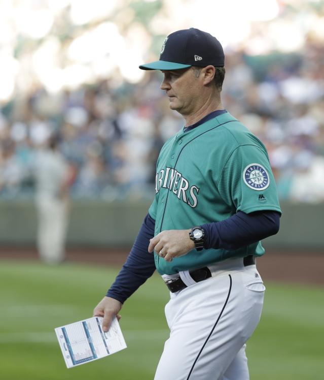 Seattle Mariners manager Scott Servais walks to the plate to exchange lineup cards before a baseball game against the Chicago White Sox, Friday, July 20, 2018, in Seattle. (AP Photo/Ted S. Warren)