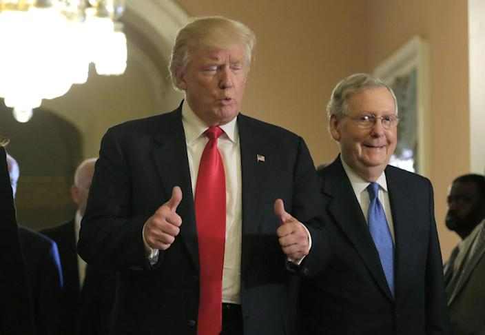 <p>U.S. President-elect Donald Trump gives a thumbs-up sign as he walks with Senate Majority Leader Mitch McConnell on Capitol Hill in Washington, Nov. 10, 2016. (Joshua Roberts /Reuters </p>