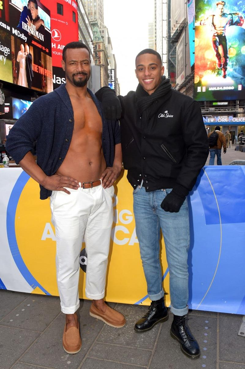 old spice guy and son in times square