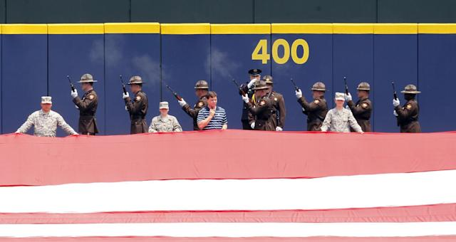 Deputy's perform a Twenty One Gun Salute before the start of a baseball game between the Boston Red Sox and the Atlanta Braves on Monday, May 26, 2014, in Atlanta, Ga. (AP Photo/Butch Dill)