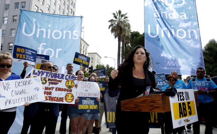 FILE - In this Aug. 28, 2019 file photo Assemblywoman Lorena Gonzalez, D-San Diego, speaks at rally calling for passage of her measure to limit when companies can label workers as independent contractors at the Capitol in Sacramento, Calif. A group called Protect App-Based Drivers and Services announced Tuesday, Oct. 29, 2019, that it will push a ballot initiative guaranteeing that drivers remain independent contractors. (AP Photo/Rich Pedroncelli, File)