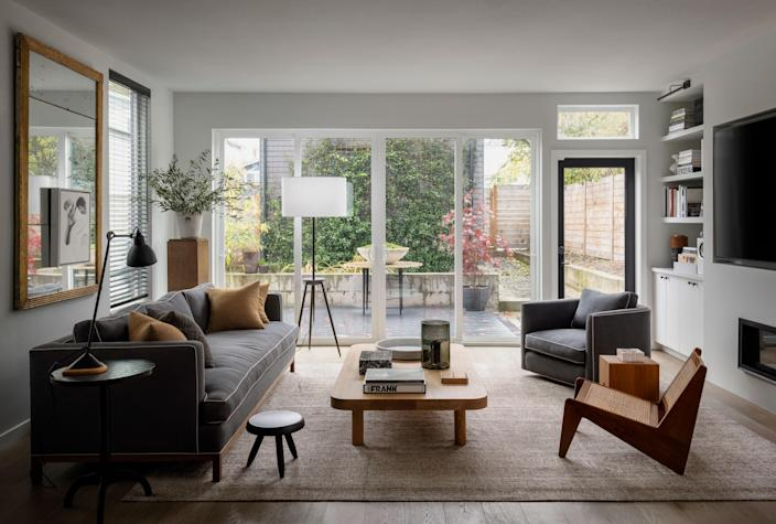 """The geometric floor lamp in the living room is from BDDW, one of Paquette's favorite New York furniture stores. """"This floor lamp was one of the first pieces that [owner] Tyler [Hays] introduced when he opened BDDW, so it's very emblematic of their brand,"""" says Paquette."""