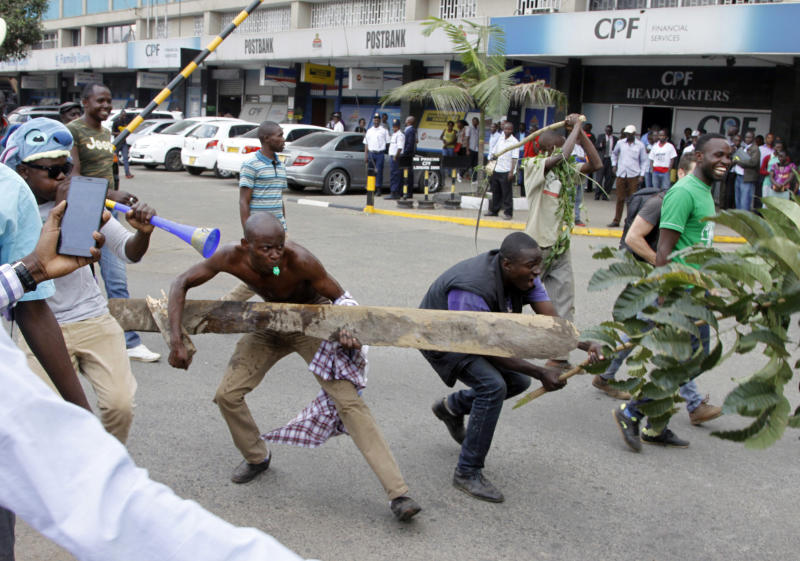 Opposition Supporters demonstrate against the Independent Electoral and Boundaries Commission (IEBC) in Nairobi, Kenya, Wednesday, Oct. 11, 2017. The protesters are demanding a change of leadership at the country's election commission. The protests took place in the capital Nairobi and the opposition stronghold of Kisumu, in western Kenya, as well as in the coastal city of Mombasa.(AP Photo/Khalil Senosi)