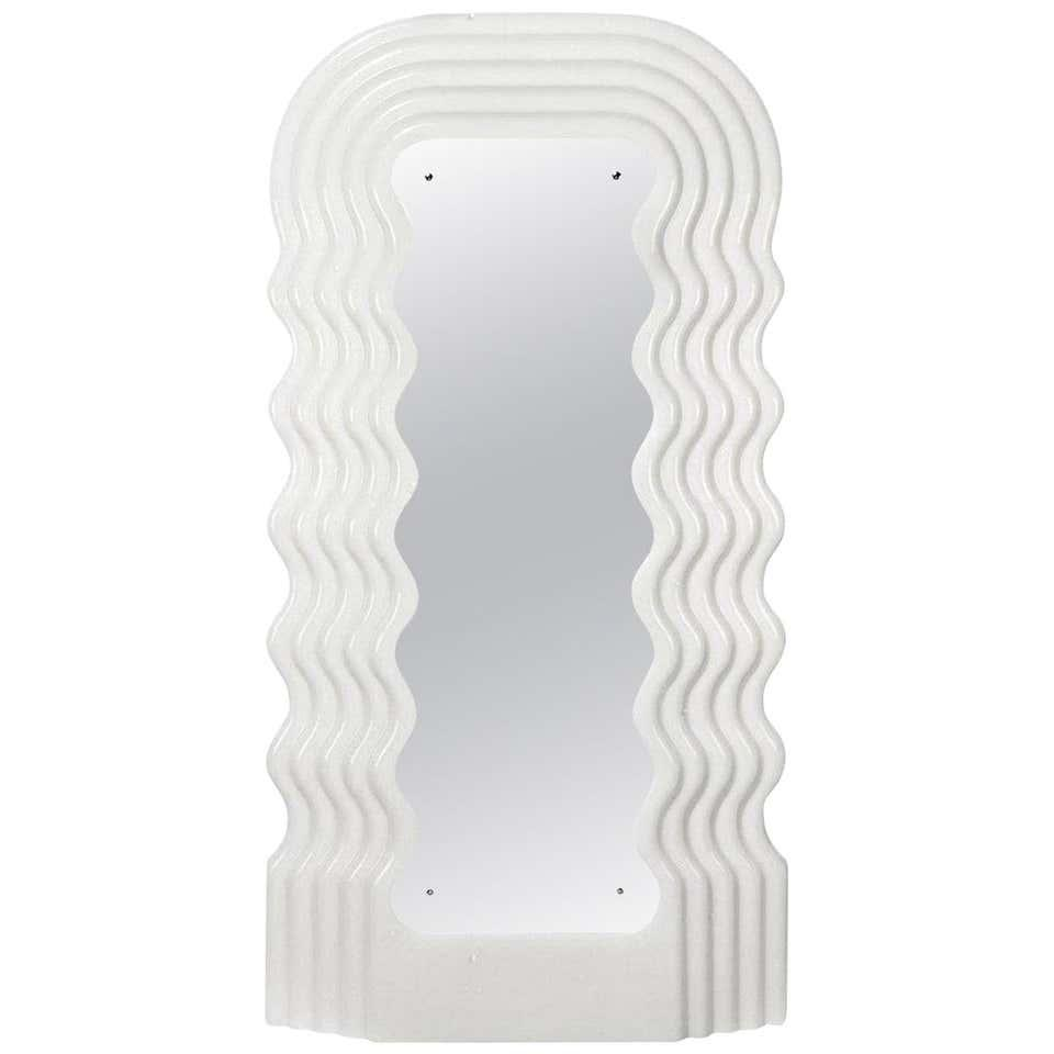 """<br><br><strong>Ettore Sottsass</strong> Ultrafragola Mirror Prod. Poltronova, Italy, $, available at <a href=""""https://go.skimresources.com/?id=30283X879131&url=https%3A%2F%2Fwww.1stdibs.com%2Ffurniture%2Fmirrors%2Fwall-mirrors%2Fettore-sottsass-ultrafragola-mirror-prod-poltronova-italy%2Fid-f_21994352%2F"""" rel=""""nofollow noopener"""" target=""""_blank"""" data-ylk=""""slk:1st Dibs"""" class=""""link rapid-noclick-resp"""">1st Dibs</a>"""
