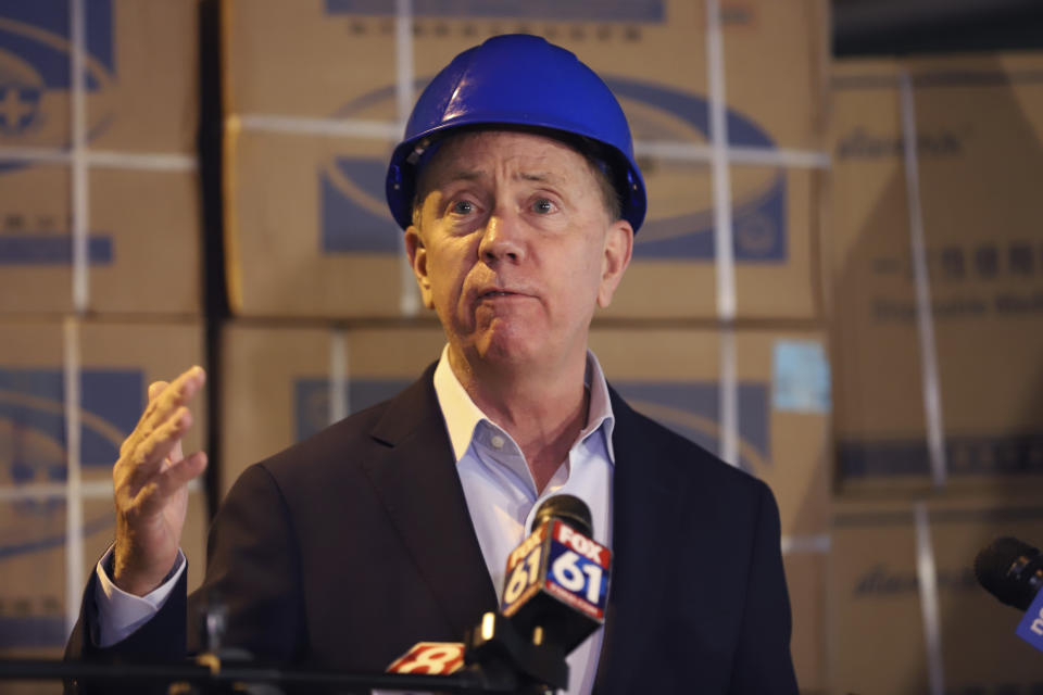 Connecticut Gov. Ned Lamont speaks to the media about the shipment of personal protective equipment from China donated to the state to aid Connecticut's frontline workers in the battle against COVID-19, Tuesday, May 12, 2020 in New Britain, Conn. Lamont thanked China and the China Construction Bank, which donated a large portion of PPE. (AP Photo/Chris Ehrmann)