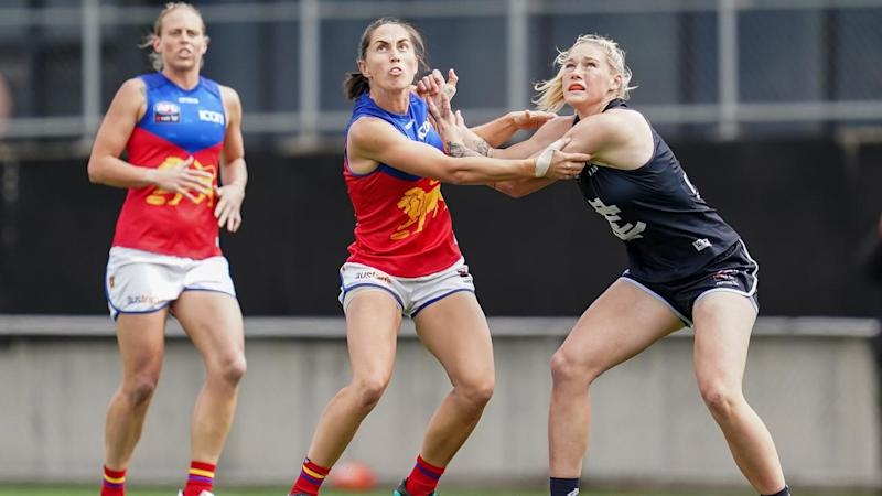 Carlton star Tayla Harris (R) faces a possible AFLW preliminary final suspension for a sling tackle
