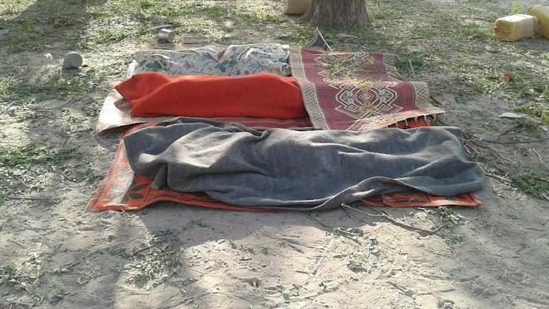Bodies covered with blankets are pictured in Rann, northeast Nigeria on January 17, 2017 after an an air force jet accidentally bombarded a camp for displaced people