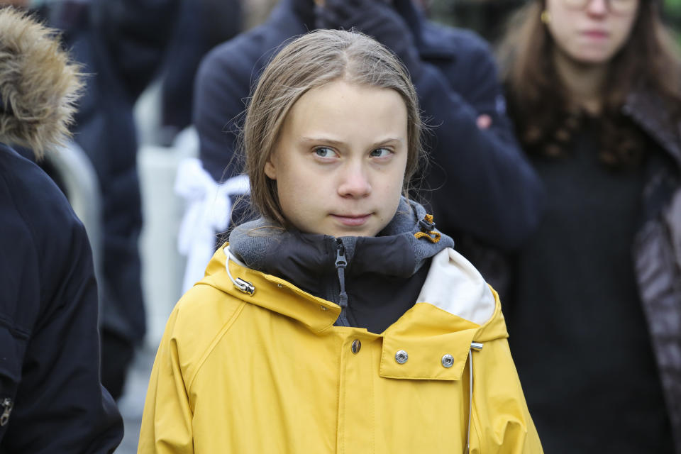 16-year-old Swedish climate change activist, Greta Thunberg takes part in the Fridays For Future rally in Piazza Castello on December 13, 2019, in Turin, Italy  - Thunberg rose to international prominence last August for organising the first 'School strike for climate', also known as Fridays For Future, a global movement of school students who swap classes for demonstrations to demand action to prevent further global warming and climate change. (Photo by Massimiliano Ferraro/NurPhoto via Getty Images)